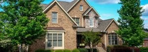 Calgary brick home with a good roofing contractor