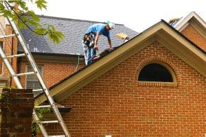 installing new shingles on a Calgary home
