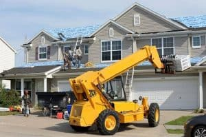 Calgary-roofing adding shingles
