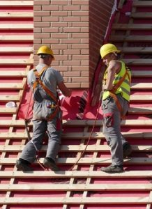 Calgary roofing team workers shingling a new roof